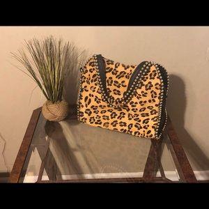 Big Buddha Grayson Leopard skin saddle bag.
